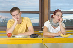 Demotivated lecture. Demotivated bored frustrated school students in lecture stock photos