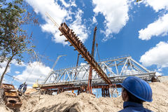 Demount a piece of bridge. Process of demounting rafler under the bridge Royalty Free Stock Image