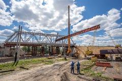 Demounting beam. Demounting big metal beam from bridge Royalty Free Stock Photos