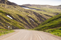 Dempster Highway into a valley Stock Image