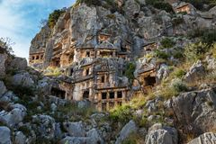 Demre. Tombs of the Ancient Mira. Tomb carved in rocks in ancient lycian necropolis in Mira, Demre, Turkey Stock Image