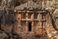 Demre. Tombs of the Ancient Mira. Tomb carved in rocks in ancient lycian necropolis in Mira, Demre, Turkey Stock Photos