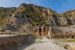 Demre. Tombs of the Ancient Mira. Tomb carved in rocks in ancient lycian necropolis in Mira, Demre, Turkey Royalty Free Stock Photo