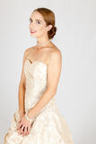 Demure lady. Pretty woman in fabulous gown Royalty Free Stock Photography