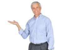 den åldriga blåa manmitten gömma i handflatan skjortan upp Royaltyfri Foto
