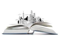 Den öppna boken på tabellen med staden skissar Fotografering för Bildbyråer