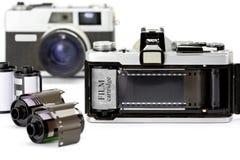 Den 35mm kameran med filmen Arkivbild