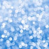 Den abstrakt bluen sparkles defocused bakgrund Royaltyfri Fotografi