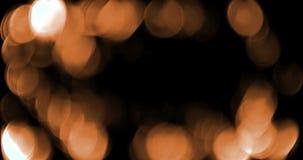 Den abstrakta guld- gnistrandet bubblar partikelbokeh på svart bakgrund, ferie för lyckligt nytt år för händelse festlig lager videofilmer