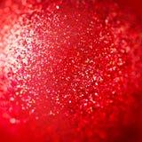 Den abstrakta julkortet med rött mousserar Arkivfoton