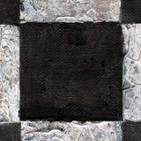 Den abstrakta rutiga modellen målade med akryl eller olje- målarfärger på kanfas i svartvita färger arkivfoto
