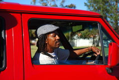 den afrikanska chauffören taxar Arkivbild