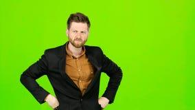 Den aggressiva mannen, är kan han ilsken alls och inte stoppas grön skärm lager videofilmer
