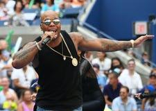 Den amerikanska rapparen, sångaren och låtskrivaren Flo Rida deltar på Arthur Ashe Kids Day 2016 arkivfoton