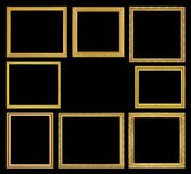 Den antika guld- ramen på svart bakgrund Arkivfoto