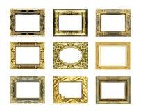 Den antika guld- ramen på vit Arkivbilder