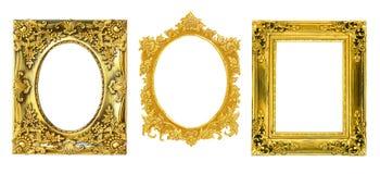 Den antika guld- ramen på den vita bakgrunden Arkivfoto