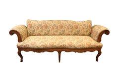 Den antika lyxiga soffan, med infall sned träramen och garnering Royaltyfria Foton
