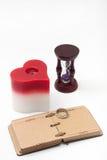 Den antika retro dagboken och stearinljuset i hjärta formar Fotografering för Bildbyråer