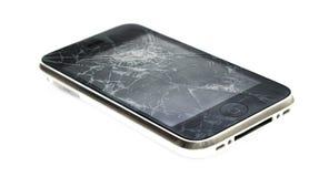 Den Apple iPhonen med ett brutet avskärmer arkivfoton