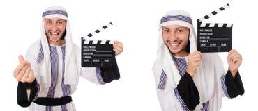 Den arabiska mannen med clapper-brädet som isoleras på vit royaltyfri fotografi
