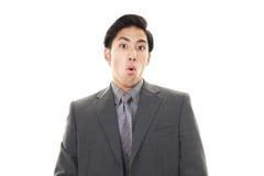 den asiatiska affärsmannen förvånade royaltyfri foto