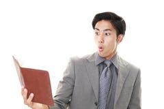 den asiatiska affärsmannen förvånade royaltyfria foton