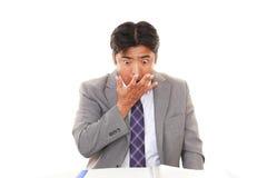 den asiatiska affärsmannen förvånade arkivfoto