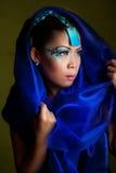 den asiatiska bluen skyler kvinnan royaltyfria foton