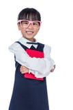 Den asiatiska kinesiska grundskola för barn mellan 5 och 11 årflickan i enhetligt innehav bokar Arkivfoto