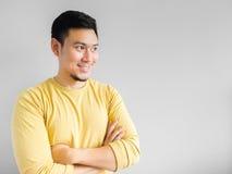 Den asiatiska mannen tänker Arkivfoton