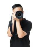 Den asiatiska mannen tar fotoet Arkivfoto