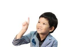Den asiatiska pojken gör uttryck fotografering för bildbyråer
