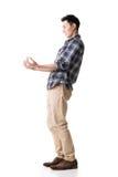 Den asiatiska unga grabben bär eller tar något Arkivbilder