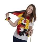 Den attraktiva kvinnan visar den tyska flaggan royaltyfri foto