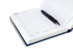 Den automatiska pennan ligger på det vecko Allt på en vit bakgrund, isolat fotografering för bildbyråer