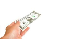 den away dollaren ger en Arkivfoto