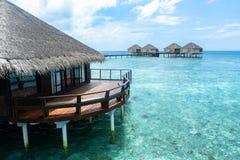 Den bästa all-inklusive Maldiverna vatten-villan tillgriper i Maldiverna Royaltyfri Foto