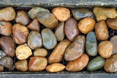 den bakgrund exponerade rocken stenar sunen Arkivbild