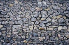 den bakgrund gjorda stenen stenar texturväggwhite Arkivbilder
