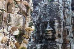 Den Bayon stenen vänder mot i den Bayon templet på Angkor, Cambodja Fotografering för Bildbyråer