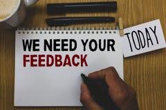 Den begreppsmässiga handhandstilvisningen behöver vi din återkoppling Affärsfototext ger oss dina granskningtankar kommentarer va royaltyfri bild