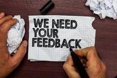 Den begreppsmässiga handhandstilvisningen behöver vi din återkoppling Affärsfototext ger oss dina granskningtankar kommentarer va arkivfoto