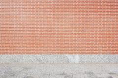 Den belade med tegel väggen och stenen för röd tegelsten däckar bakgrund Fotografering för Bildbyråer