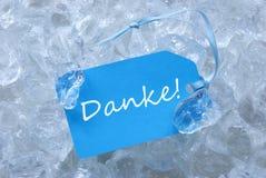 Den blåa etiketten på is med Danke hjälpmedel tackar dig Fotografering för Bildbyråer