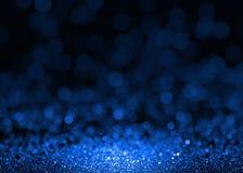 Den blåa gnistrandet blänker abstrakt bakgrund Royaltyfria Bilder