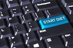 Den blåa knappen med text av starten bantar Arkivbilder