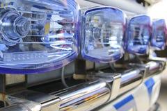 Den blåa räddningsaktionlastbilen tänder närbild Arkivfoto