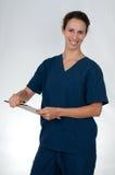 den blåa sjukvårdprofessionelln skurar Arkivbilder