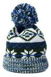 Den blåa snöflingamodellvintern skidar isolerat vitt för knyck hatten royaltyfria foton